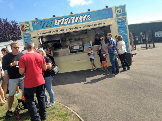 Event catering unit selling gourmet burgers to people