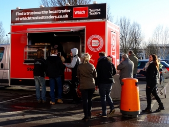 People queuing at a Which? promotional catering event.