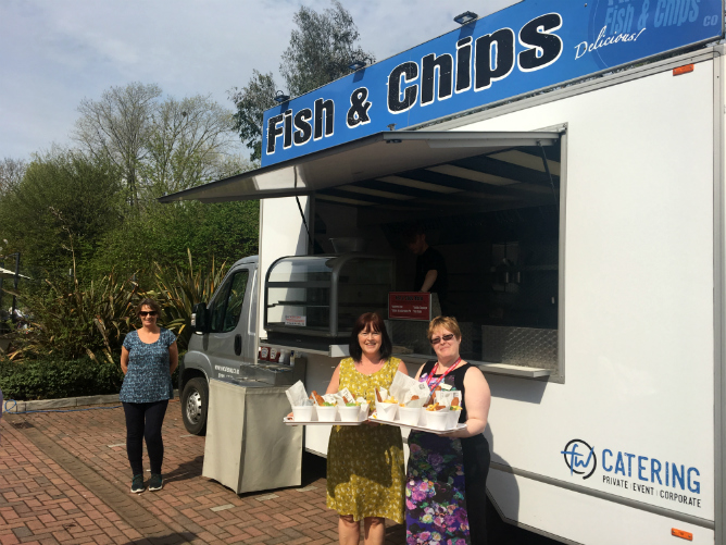Mini fish and chips about to be served in front of our fish and chips catering van.